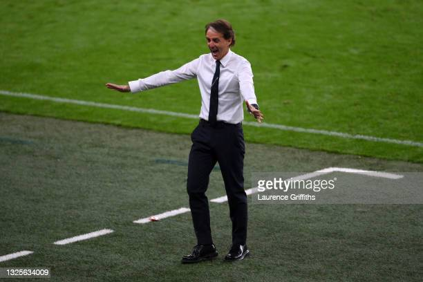 Roberto Mancini, Head Coach of Italy celebrates their side's first goal scored by team mate Federico Chiesa during the UEFA Euro 2020 Championship...
