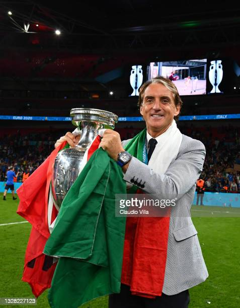 Roberto Mancini, Head Coach of Italy celebrates with The Henri Delaunay Trophy following his team's victory in the UEFA Euro 2020 Championship Final...