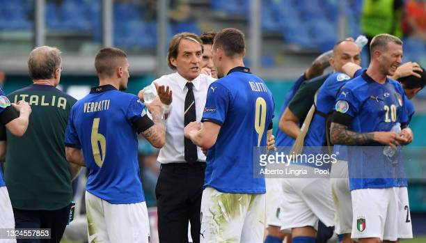 Roberto Mancini, Head Coach of Italy interacts with Marco Verratti and Andrea Belotti of Italy during the UEFA Euro 2020 Championship Group A match...