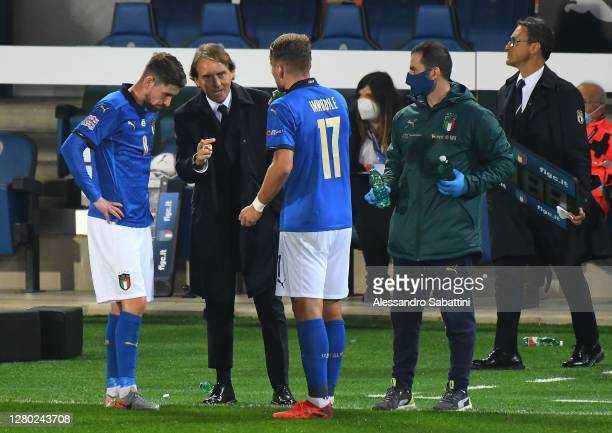 Roberto Mancini head coach of Italy issues instructions to Jorginho and Ciro Immobile of Italy during the UEFA Nations League group stage match...