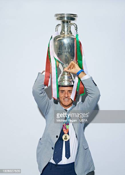 Roberto Mancini, Head Coach of Italy poses with The Henri Delaunay Trophy during an Italy Portrait Session following their side's victory in the UEFA...