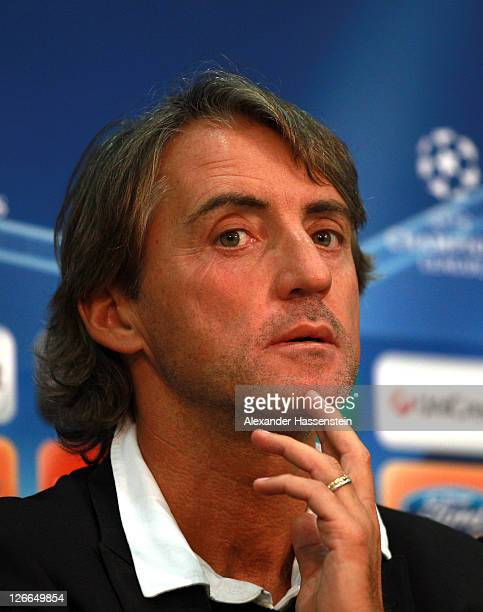 Roberto Mancini, head coach of Manchester City looks on during a press conference ahead of the UEFA Champions League group A first leg match against...
