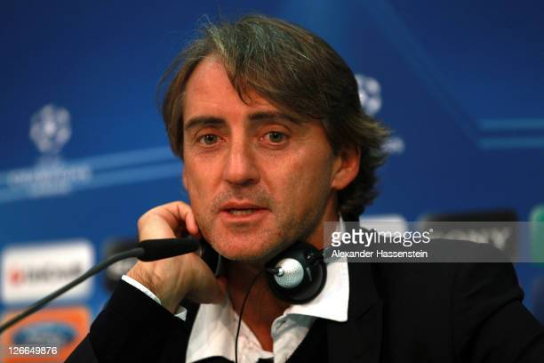 Roberto Mancini, head coach of Manchester City talks to the media during a press conference ahead of the UEFA Champions League group A first leg...