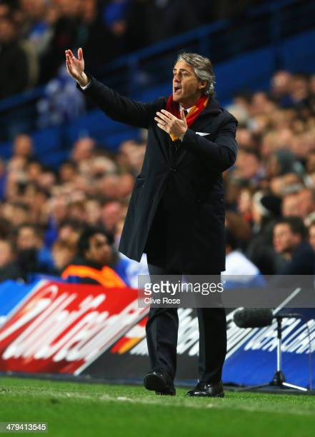 Roberto Mancini manager of Galatasaray gives instructions during the UEFA Champions League Round of 16 second leg match between Chelsea and...