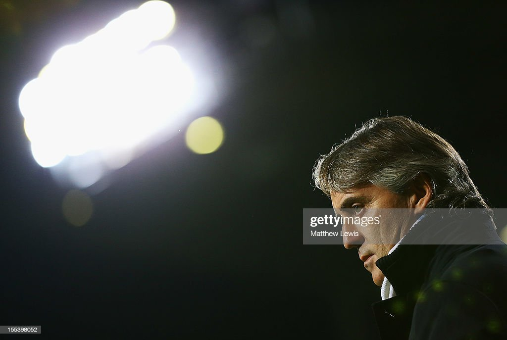Roberto Mancini, manager of Manchester City looks on prior to the Barclays Premier League match between West Ham United and Manchester City at the Boleyn Ground on November 3, 2012 in London, England.