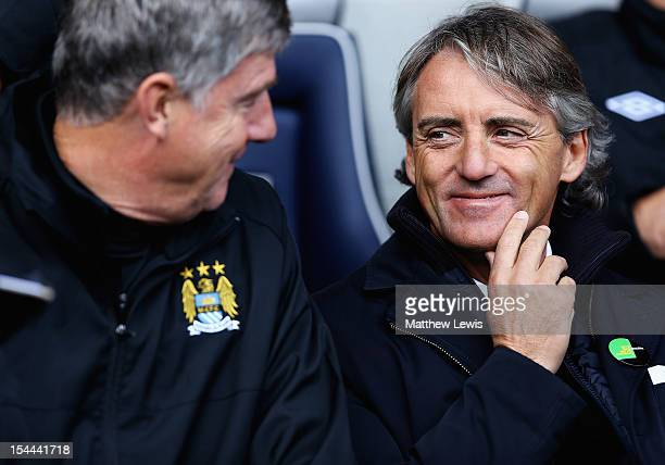 Roberto Mancini manager of Manchester City looks on with Brian Kidd during the Barclays Premier League match between West Bromwich Albion and...