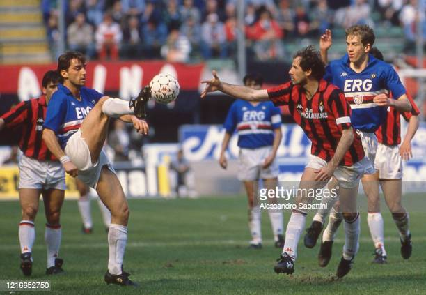 Roberto Mancini of Sampdoria competes for the ball with Franco Baresi of AC Milan during the Seria A match between AC Milan and Sampdoria, Italy.