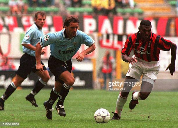 Roberto Mancini of SS Lazio and Marcell Desailly of AC Milan compete for the ball during the Serie A match between Milan and Lazio played at San Siro...