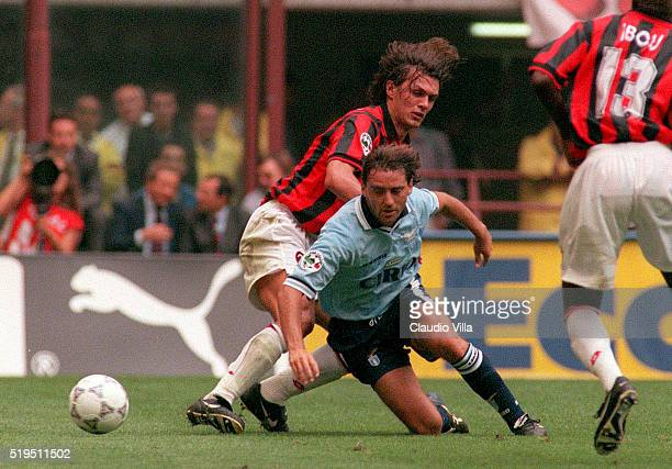 Roberto Mancini of SS Lazio and Paolo Maldini of AC Milan compete for the ball during the Serie A match between Milan and Lazio played at San Siro...