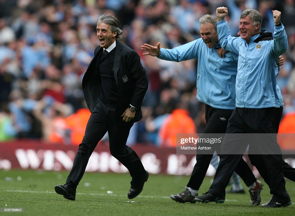 Roberto Mancini the head coach / manager of Manchester City celebrates after Sergio Aguero of Manchester City scores the winning goal to make it 3-2