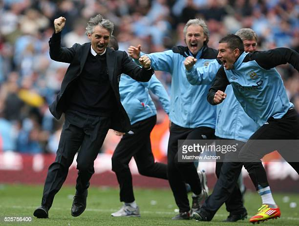 Roberto Mancini the head coach / manager of Manchester City celebrates after Sergio Aguero of Manchester City scores a goal to make it 32 and...