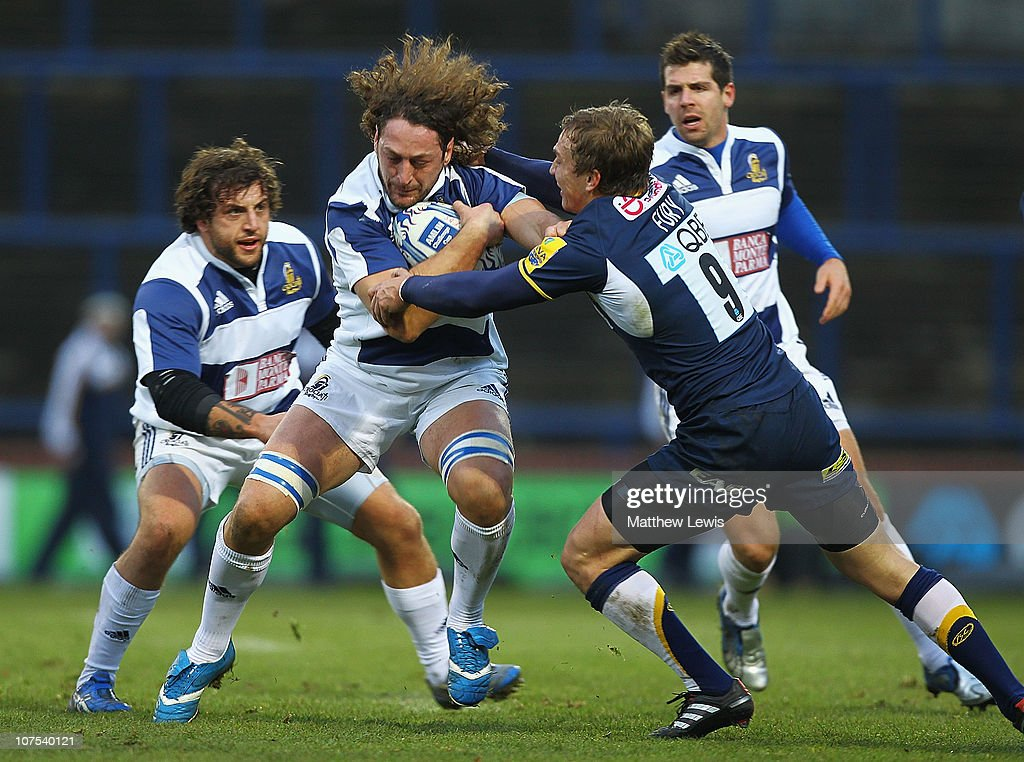 Roberto Mandelli of Crociati Rugby is tackled by Warren Fury of Leeds during the Amlin Challenge Cup game against Leeds Carnegie and Crociati Rugby at Headingley Carnegie Stadium on December 12, 2010 in Leeds, England.