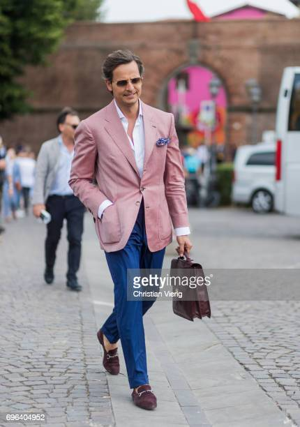 Roberto Mararo wearing a pink jacket blue pants hand bag is seen during Pitti Immagine Uomo 92 at Fortezza Da Basso on June 15 2017 in Florence Italy