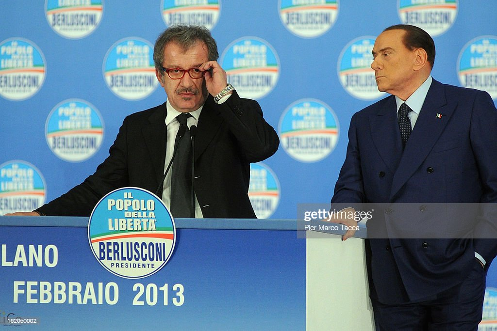 Roberto Maroni, Northern League Party Secretary and candidate for governor of the Lombardy region in the next regional elections, speaks with former Italian Prime Minister Silvio Berlusconi during a political rally on February 18, 2013 in Milan, Italy. Berlusconi is entering the last week of campaigning for his party Popolo della Liberta. Italians go to the polls February 24-25.