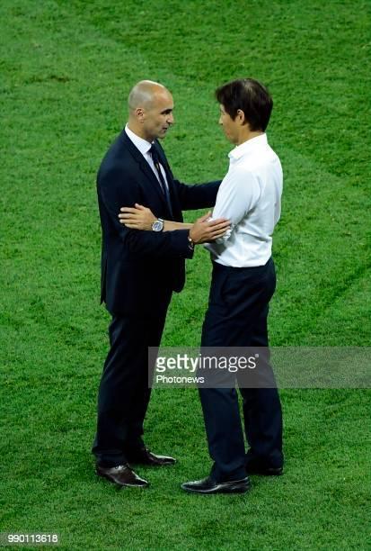 Roberto Martinez head coach of Belgian Team Akira Nishino head coach of Japan during the FIFA 2018 World Cup Russia Round of 16 match between Belgium...