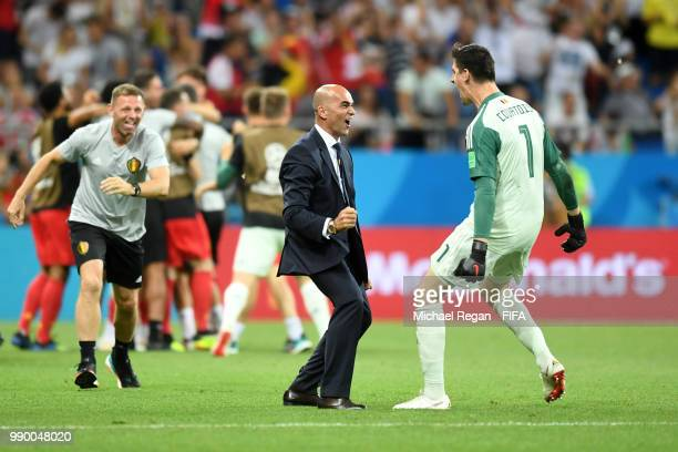 Roberto Martinez, Head coach of Belgium and Thibaut Courtois of Belgium celebrate after their sides third goal during the 2018 FIFA World Cup Russia...