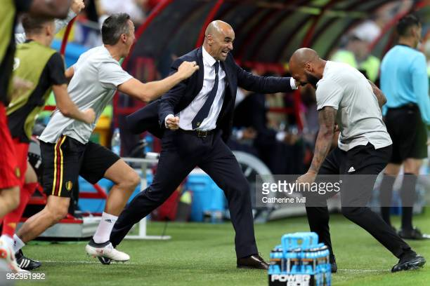 Roberto Martinez Head coach of Belgium celebrates with Belgium assistant coach Thierry Henry after their sides first goal during the 2018 FIFA World...