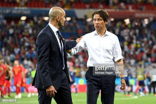 Roberto Martinez Head coach of Belgium congratulates Akira Nishino Manager of Japan following the 2018 FIFA World Cup Russia Round of 16 match...