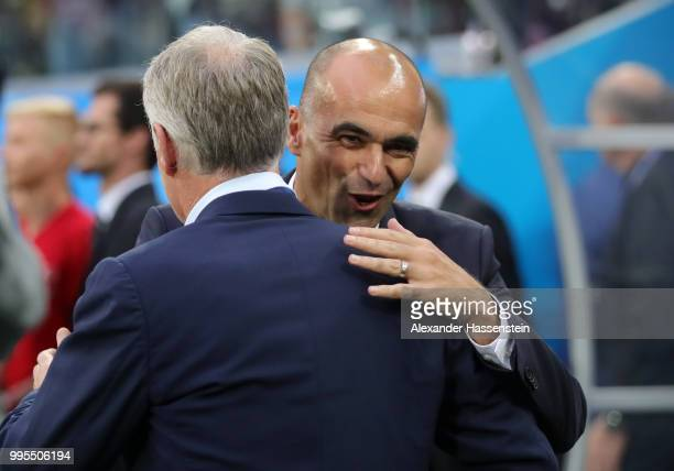 Roberto Martinez Head coach of Belgium greets Didier Deschamps Manager of France prior to the 2018 FIFA World Cup Russia Semi Final match between...