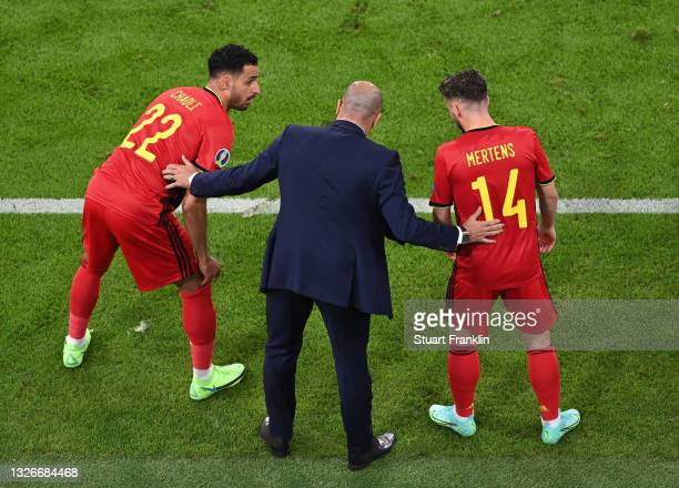 Roberto Martinez, Head Coach of Belgium interacts with Nacer Chadli and Dries Mertens of Belgium as they prepare to come on as substitutes during the...