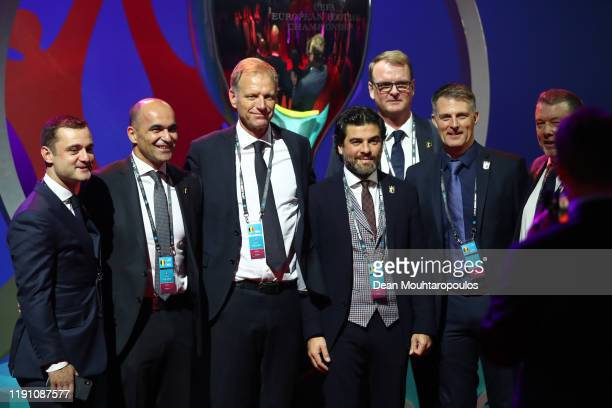 Roberto Martinez Manager of Belgium and his back room staff pose for a photo prior to the UEFA Euro 2020 Final Draw Ceremony at the Romexpo on...
