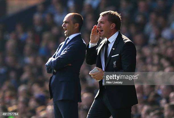 Roberto Martinez manager of Everton and Brendan Rodgers manager of Liverpool on the touchline during the Barclays Premier League match between...