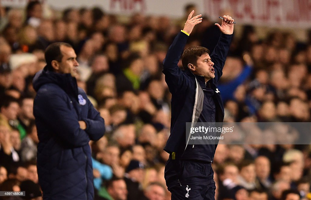Roberto Martinez, manager of Everton and Manager Mauricio Pochettino of Spurs on the touchline during the Barclays Premier League match between Tottenham Hotspur and Everton at White Hart Lane on November 30, 2014 in London, England.
