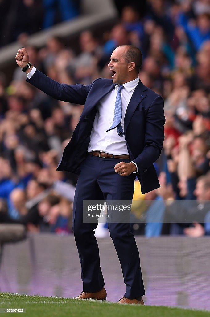 Roberto Martinez, manager of Everton celebrates the second goal scored by Steven Naismith during the Barclays Premier League match between Everton and Chelsea at Goodison Park on September 12, 2015 in Liverpool, United Kingdom.