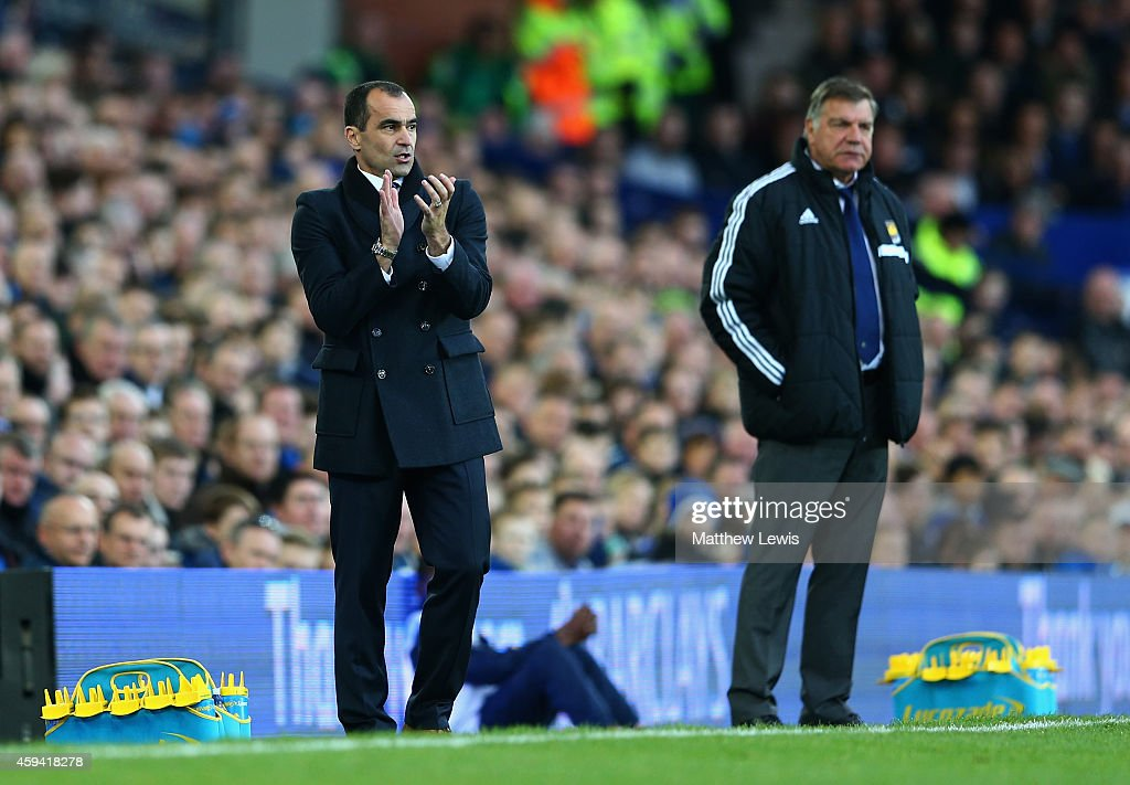 Roberto Martinez, manager of Everton encourages his team with Sam Allardyce, manager of West Ham United during the Barclays Premier League match between Everton and West Ham United at Goodison Park on November 22, 2014 in Liverpool, England.