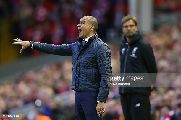 Roberto Martinez Manager of Everton reacts whilst Jurgen Klopp manager of Liverpool looks on during the Barclays Premier League match between...