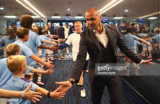 Roberto Martinez Manager of Premier League All Stars XI greets mascots in the tunnel prior to Vincent Kompany's Testimonial Match between Manchester...