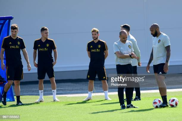 Roberto Martinez manager of the Belgium national football team talking to Thierry Henry ass coach of Belgian Team during a training session as part...