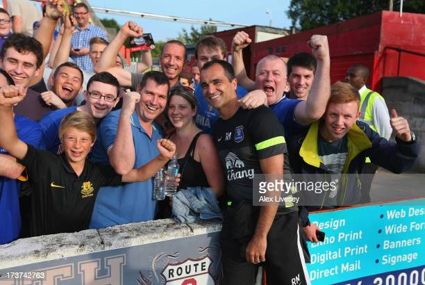 Roberto Martinez the manager of Everton meets supporters prior to a pre season friendly match between Accrington Stanley and Everton at The Store...