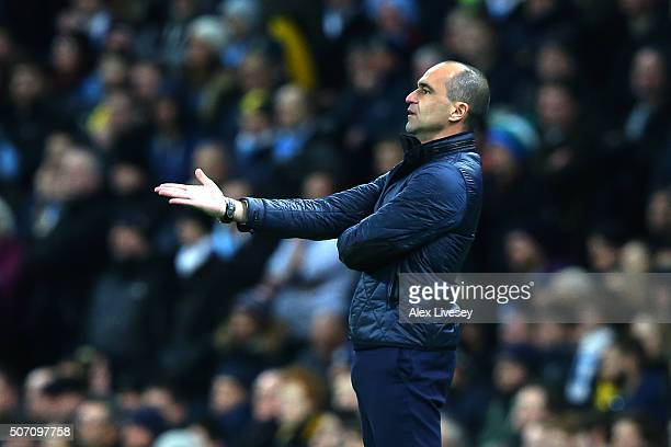 Roberto Martinez the manager of Everton reacts during the Capital One Cup Semi Final second leg match between Manchester City and Everton at the...