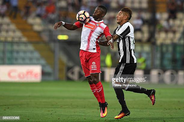 Roberto Maximilian Pereyra of FC Juventus competes with Pape Diop of Espanyol during the PreSeason Friendly match between FC Juventus and Espanyol at...