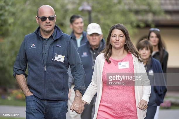 Roberto Mignone managing partner for Bridger Management LLC and his with his wife Allison Mignone arrive to the morning sessions during the Allen Co...