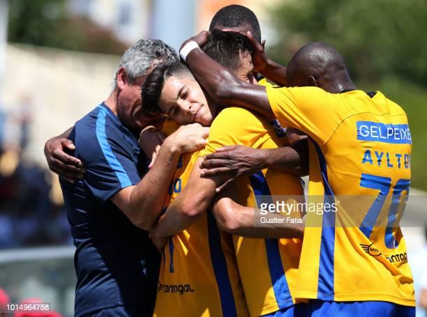 Roberto of GD Estoril Praia celebrates with teammates after scoring a goal during the Portuguese Segunda Liga match between GD Estoril Praia and FC...