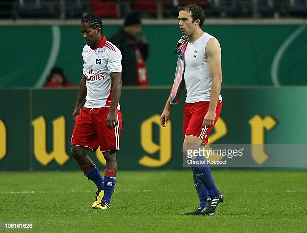 Zé Roberto of Hamburg and Joris Mathijsen of Hamburg look dejected after the DFB Cup match between Eintracht Frankfurt and Hamburger SV at...