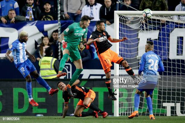 Roberto of Malaga CF Francis Coquelin of Valencia CF during the La Liga Santander match between Malaga v Valencia at the Estadio La Rosaleda on...