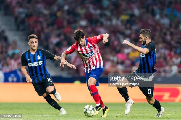 Roberto Olabe of Atletico de Madrid fights for the ball with Roberto Gagliardini and Lautaro Javier Martinez of FC Internazionale during their...