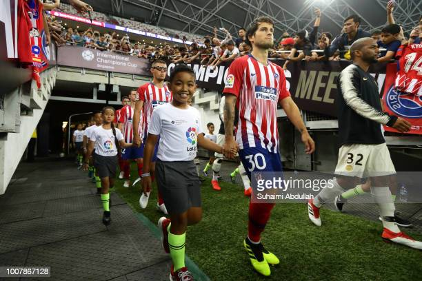 Roberto Olabe of Atletico Madrid and Kevin Rimane of Paris Saint Germain walk out of the player tunnel during the International Champions Cup 2018...
