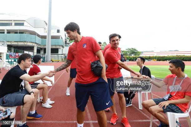 Roberto Olabe of Atletico Madrid greets Cerebral Palsy Alliance Singapore beneficiaries upon arrival for training ahead of the International...