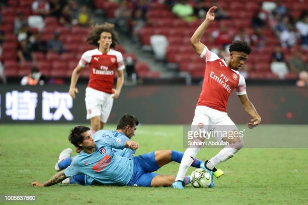 Roberto Olabe of Atletico Madrid tackles Reiss Nelson of Arsenal during the International Champions Cup 2018 match between Atletico Madrid and...