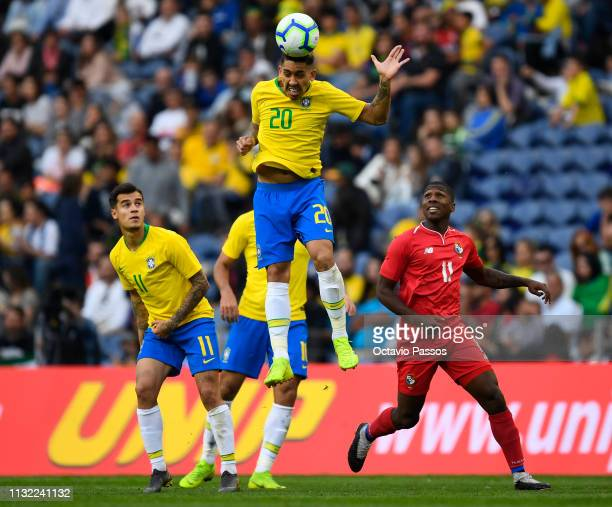 Roberto Oliveira of Brazil competes for the ball with Armando Cooper of Panama during the international friendly match between Brazil and Panama at...