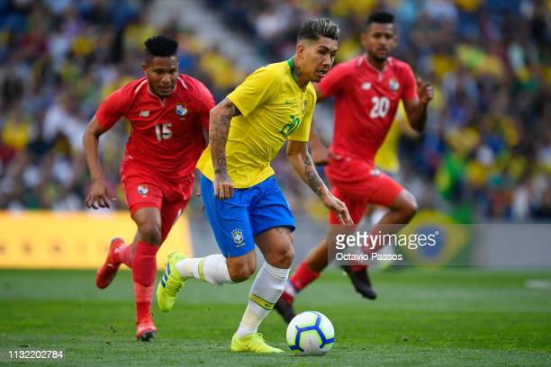Roberto Oliveira of Brazil competes for the ball with Eric Davis of Panama during the international friendly match between Brazil and Panama at...
