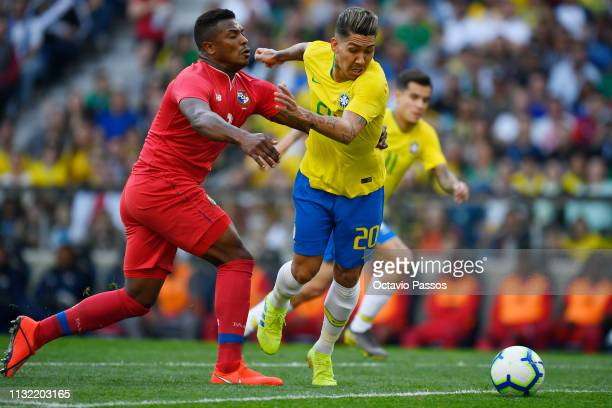Roberto Oliveira of Brazil competes for the ball with Harold Cumminas of Panama during the international friendly match between Brazil and Panama at...