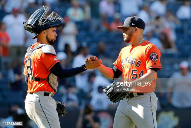 Roberto Osuna and Robinson Chirinos of the Houston Astros celebrate after defeating the New York Yankees at Yankee Stadium on June 23 2019 in New...