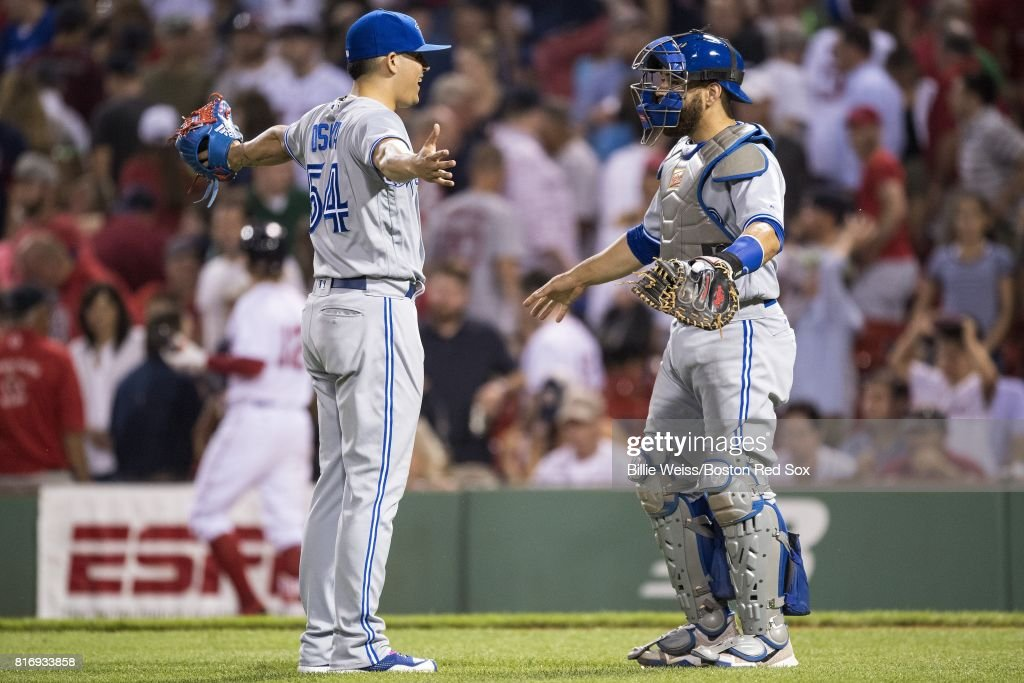 Roberto Osuna #54 and Russell Martin #55 of the Toronto Blue Jays celebrate a victory against the Boston Red Sox on July 17, 2017 at Fenway Park in Boston, Massachusetts.