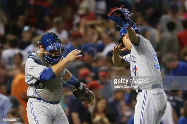 Roberto Osuna and Russell Martin of the Toronto Blue Jays dab in celebration after a victory over the Boston Red Sox at Fenway Park on July 17 2017...