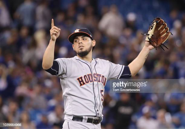 Roberto Osuna of the Houston Astros celebrates after getting the final out of the game during MLB game action against the Toronto Blue Jays at Rogers...